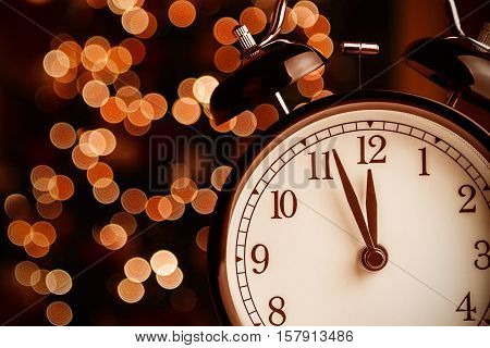 Vintage Alarm Clock Is Showing Midday Or Midnight. It Is Twelve O'clock, Christmas And Bokeh, Holida
