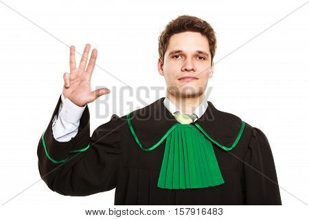 Understanding and explaining sending clear message. Young lawyer wear polish toga and show hand sign. Man make gesture hold four fingers in air.