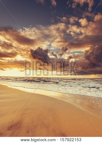 Amazing colorful sunset over evening sea horizon clouds sky and sandy beach. Tranquil scene. Natural background. Landscape.