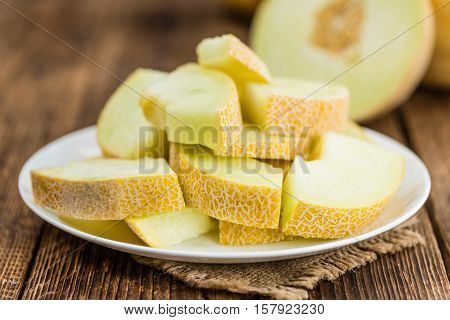 Wooden Table With Honeydew Melon (selective Focus)