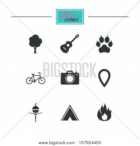 Tourism, camping icons. Fishing, fire and bike signs. Guitar music, photo camera and paw with clutches. Black flat icons. Classic design. Vector