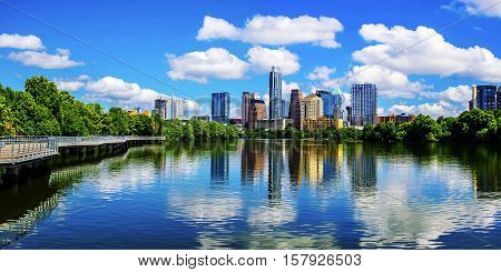Panoramic Austin Texas Mirror Reflection on the water symmetric Skyline Cityscape summer landscape at Town Lake Riverside Pedestrian Bridge Lookout of the Capital Cities
