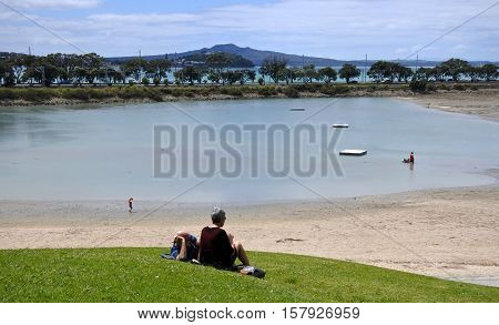 AUCKLAND - NOV 13 2016:Visitors in Dove-Myer Robinson Park and judges bay beach in Auckland New Zealand