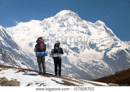 Annapurna south from mount Annapurna base camp with two tourists Nepal
