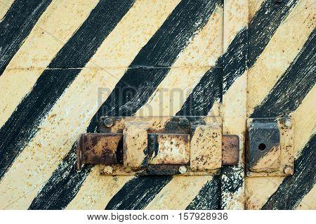 Old rusty metal door with peeling paint. Vintage texture