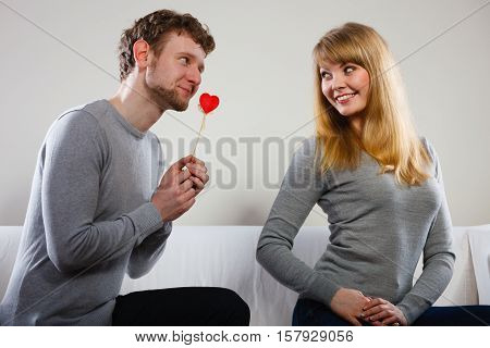 Man Giving Heart To His Girl.