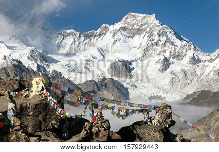 View from Gokyo Ri to mount Gyachung Kang 7952m with prayer flags near Cho Oyu way to Cho Oyu base camp Gokyo valley Sagarmatha national park Khumbu valley Nepal