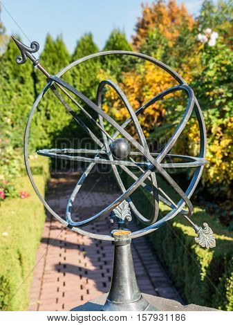 Old metal Sun Clock in the garden