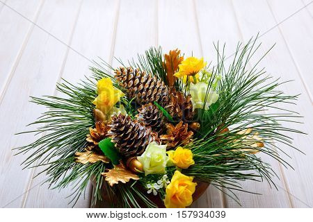 Christmas table centerpiece with golden pine cones and fir branches. Christmas background with golden decor.