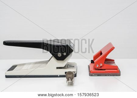 isolated close up paper punch on table