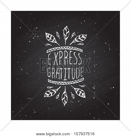 Handdrawn thanksgiving label with feathers and text on chalkboard background. Express gratitude.