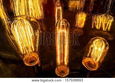 Light Bulb Ideas and Consepts historic Old Evolution of Lighting with reflections and visuals