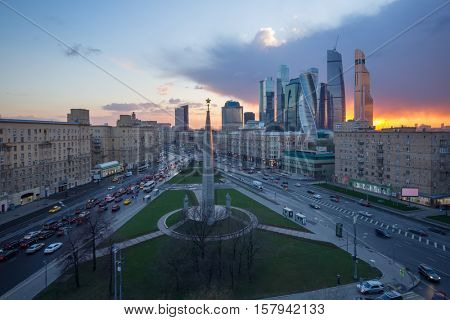 MOSCOW, RUSSIA - APR 20, 2016: Intersection of Kutuzov Avenue and Big Dorogomilovskaya street in evening. Monument Moscow Hero-city is located at this intersection