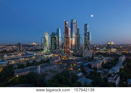 MOSCOW, RUSSIA - JUN 13, 2016: Budings of Moscow City business complex at moon night. Moscow International Business Center Moscow City includes 20 futuristic buildings