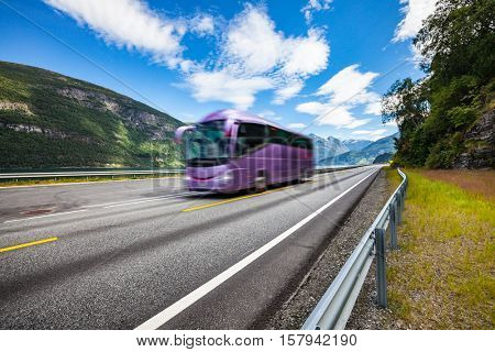 Tourist bus traveling on the road in Norway. Tourist bus in motion blur.