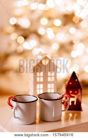 White Christmas decor over led lights bokeh. Winter mood, holiday decoration.