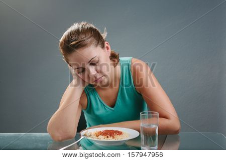 Portrait Of Woman With No Appetite In Front Of The Meal. Concept Of Loss Of Appetite