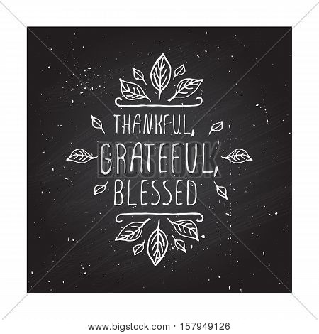 Handdrawn thanksgiving label with leaves and text on chalkboard background. Thankful, grateful, blessed.