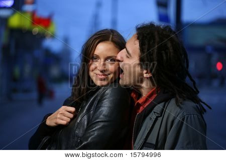 Young loving couple in a city. Biting a chick.