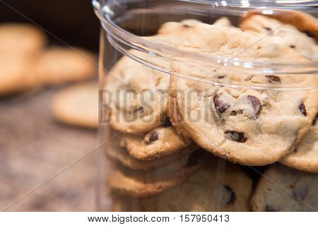 home made chocolate chip cookies on the counter in a cookie jar