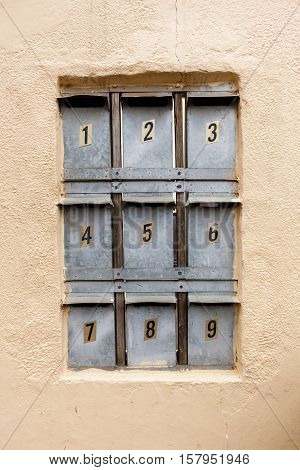 Mail box's inserted in complex condo apartment wall.