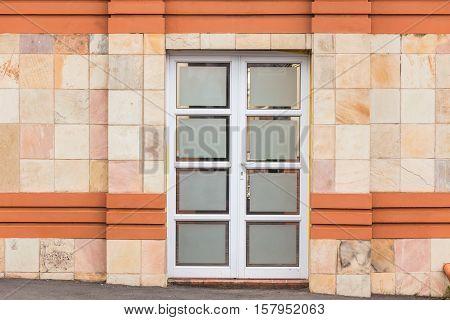 Roadside door entrance number tiled decor walls.