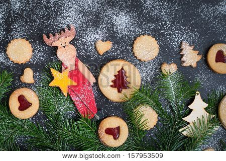 Christmas baking. Christmas toys. Copy space. Web size. Homemade cookies with strawberry jam in form of Christmas trees on a wooden background. Christmas food. New Year. Country style. Xmas card.