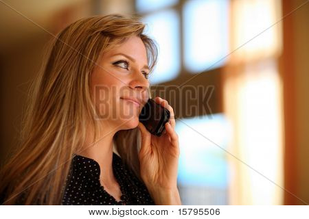 Beautiful girl talking on cell phone