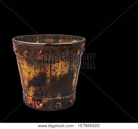 Old and rusty bucket on a black background.