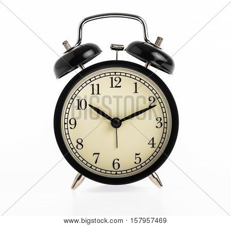 close up black alarm clock isolated on white background