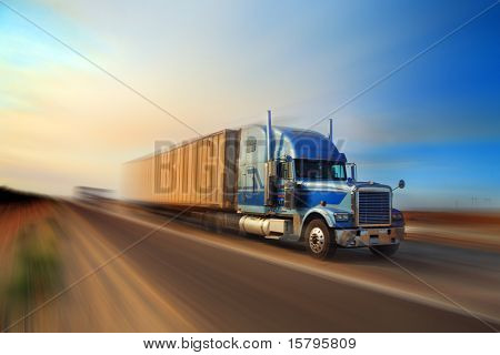 American truck speeding on freeway at sunset, motion blurred. poster