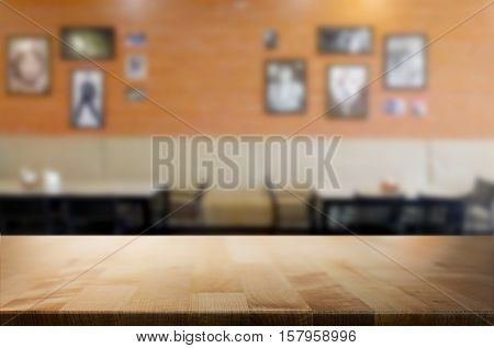 Selected focus empty brown wooden table and Coffee shop or restuarant blur background with bokeh image. for your photomontage or product display.