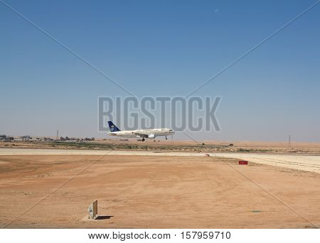 Riyadh - March 01:  Saudia plane for taking off at Riyadh King Khalid Airport on March 01, 2016 in Riyadh, Saudi Arabia. Riyadh airport is home port for Saudi Arabian Airlines.