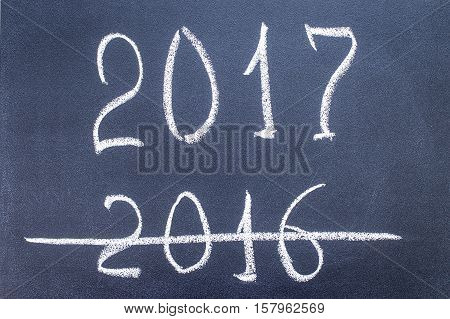 New Year 2017 is coming concept,  inscription 2016 and 2017  written on a blackboard