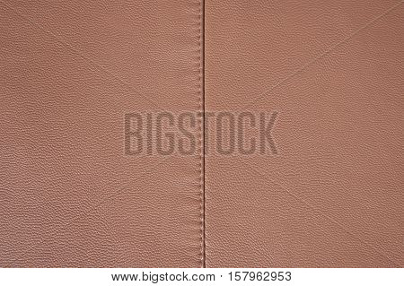 Light brown leather texture stitched in the middle