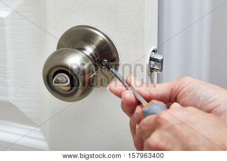 Door knob installation.