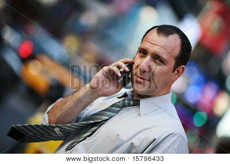 Businessman talking on cellular phone in New York city