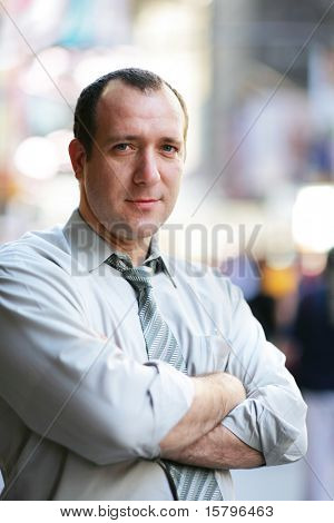 Confident mature businessman in a city