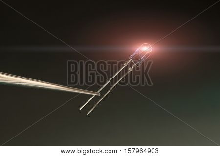 led diode on blue background. Toned Image