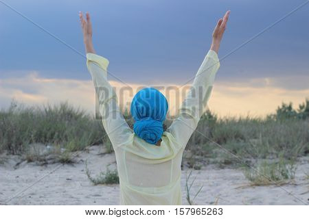 The girl clothing in Ukrainian colors blue turban and yellow blouse