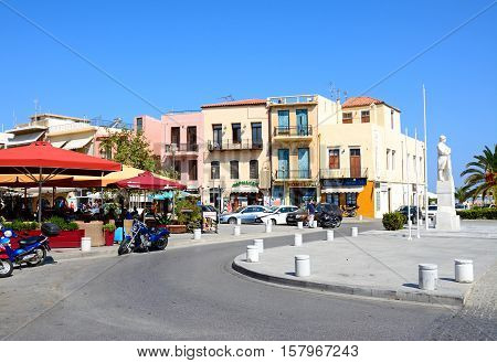 RETHYMNO, CRETE - SEPTEMBER 15, 2016 - Statue to the unknown soldier and pavement cafes in Agia Stratiota Square (Agnostou Square) Rethymno Crete Greece Europe, September 15, 2016.