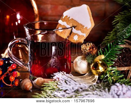 Winter hot drink. Warming mulled wine with cookie in form of house.