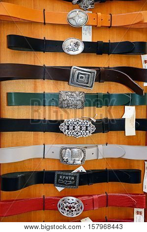RETHYMNO, CRETE - SEPTEMBER 15, 2016 - Leather belts with decorative buckles for sale in the old town Rethymno Crete Greece Europe, September 15, 2016.