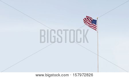 view of American flag on blue sky back. banner. lots of space for your text