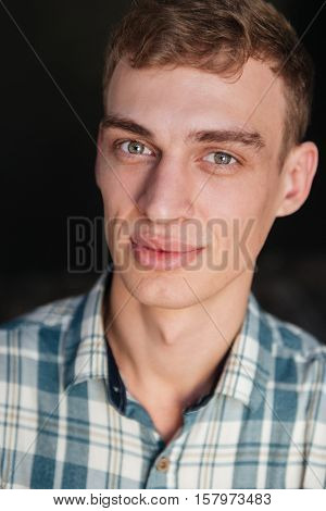 Close up man in shirt looking at camera. isolated black background