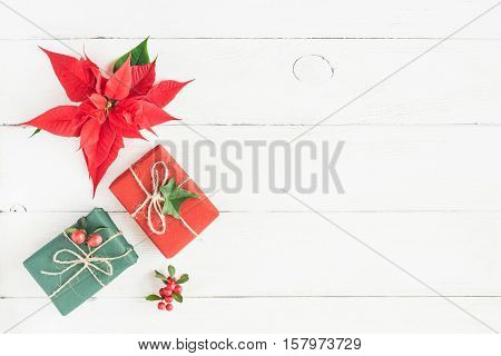 Christmas composition. Gifts fir branches christmas poinsettia. Flat lay top view