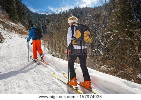 Woman practicing alpine skiing with alpine guide instructor