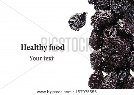 Prune closeup on white background. Isolated. Decorative border of glossy prunes. Dried fruit for vegetarian.