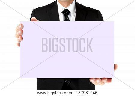 Man in suit holding blank purple card board