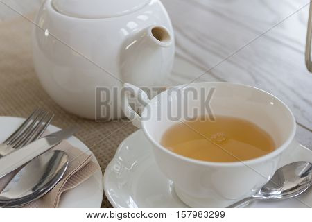 Afternoon tea with mint tea set on wooden table background get ready for drinking.
